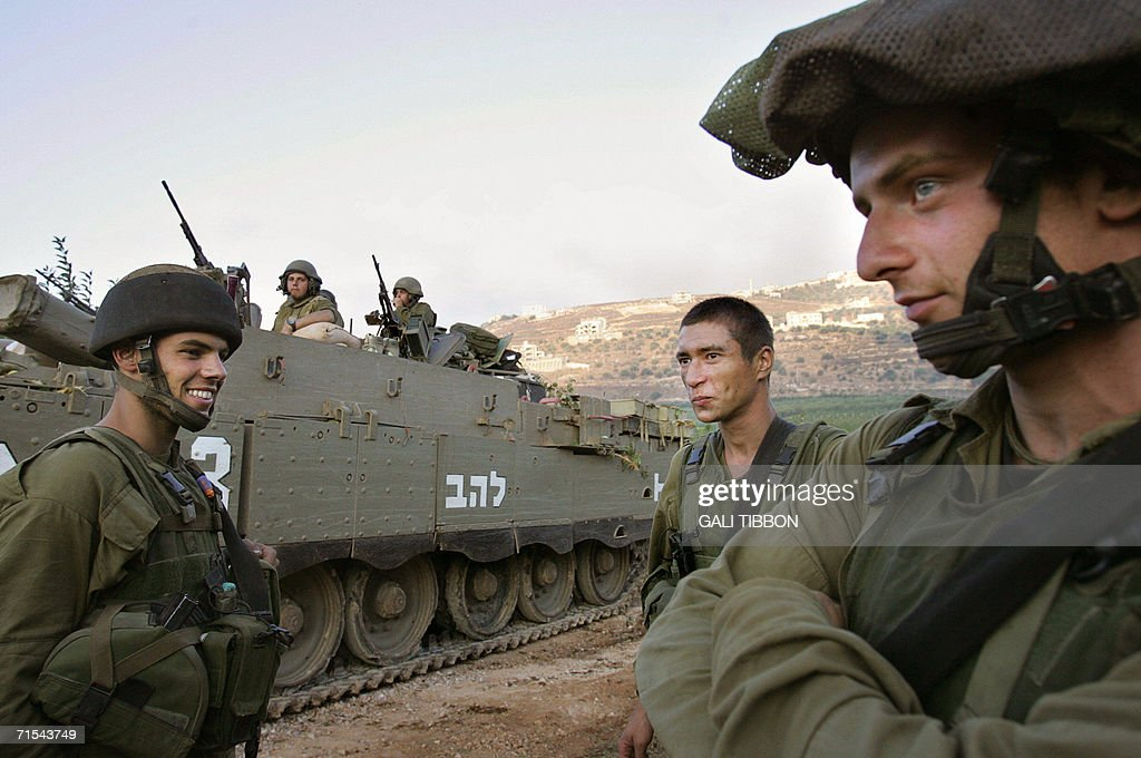 Israeli combat soldiers and an Armoured Personnel Carrier are seen along the northern Israeli border 31 July 2006 a short while after they crossed...