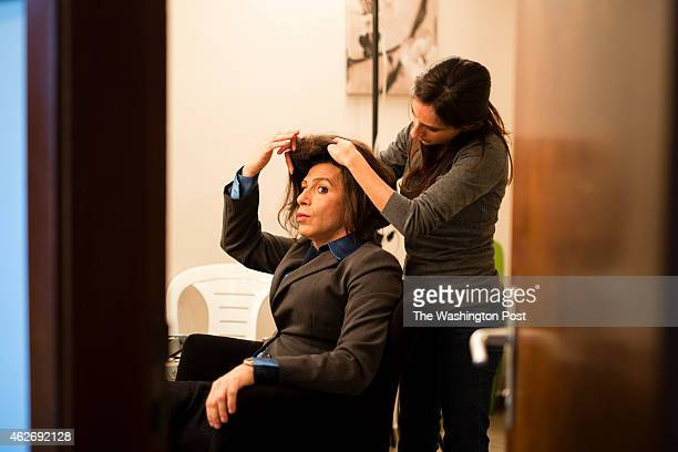 Israeli comic actor Yuval Semo who plays the role of Israeli Parliament Member Miri Regev of the Likud Party sits as he gets his hair and makeup done...