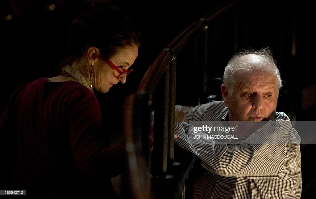 Israeli conductor Daniel Barenboim (R) and German choreographer Sasha Waltz confer during a dress rehearsall of 'Sacre' at Berlin's Staatsoper in the Schiller Theatre October 23, 2013. Sasha Waltz' show 'Sacre', which includes Claude Debussy's 'L'Apres-midi d'un Faune', Hector Berlioz' 'Scene d'Amour', and Igor Stravinsky's 'Le Sacre du Printemps' under the musical direction of Daniel Barenboim, will premiere on October 26, 2013.