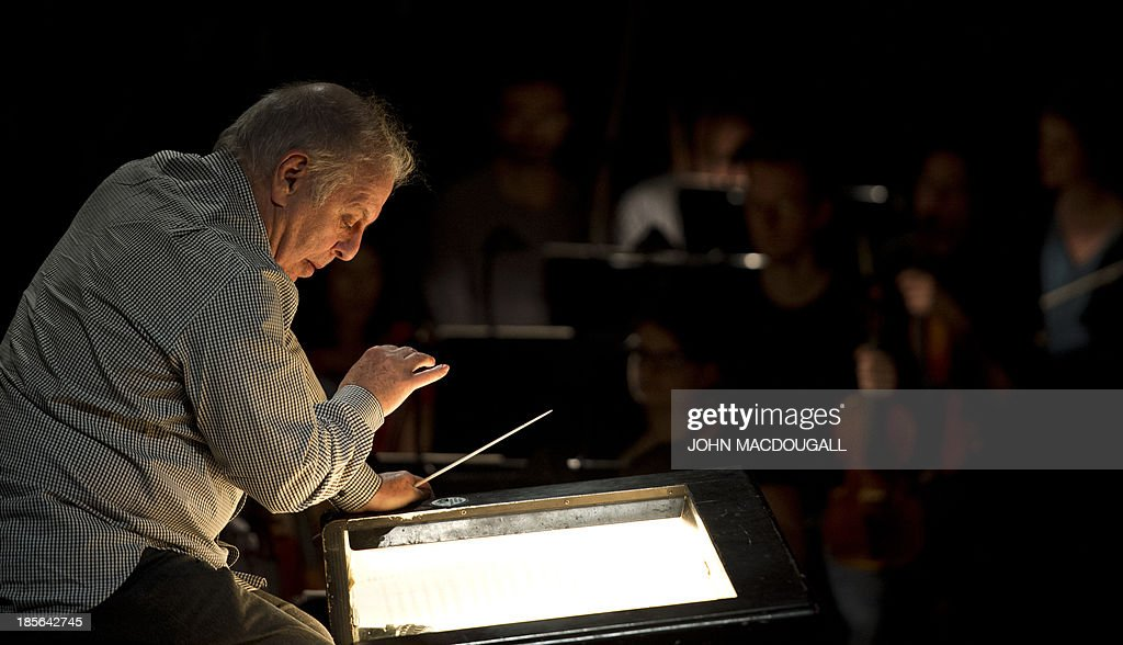 Israeli conductor Daniel Barenboim takes a break during a dress rehearsall of 'Sacre' at Berlin's Staatsoper in the Schiller Theatre on October 23, 2013. Sasha Waltz' show 'Sacre', which includes Claude Debussy's 'L'Apres-midi d'un Faune', Hector Berlioz' 'Scene d'Amour', and Igor Stravinsky's 'Le Sacre du Printemps' under the musical direction of Daniel Barenboim, will premiere on October 26, 2013.