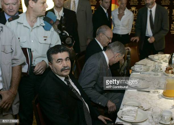 Israeli Defence Minister Amir Peretz is seen seated prior to a breakfast meeting with German Foreign Minister FrankWalter Steinmeier to discuss the...