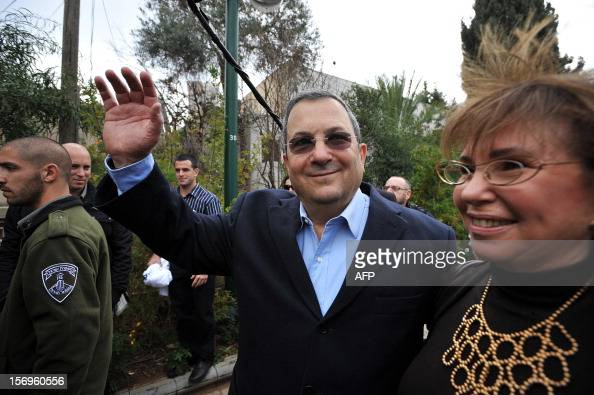 Israeli Defence Minister and Labour party leader Ehud Barak waves alongside his wife after casting his ballot at a polling station in Tel Aviv on...