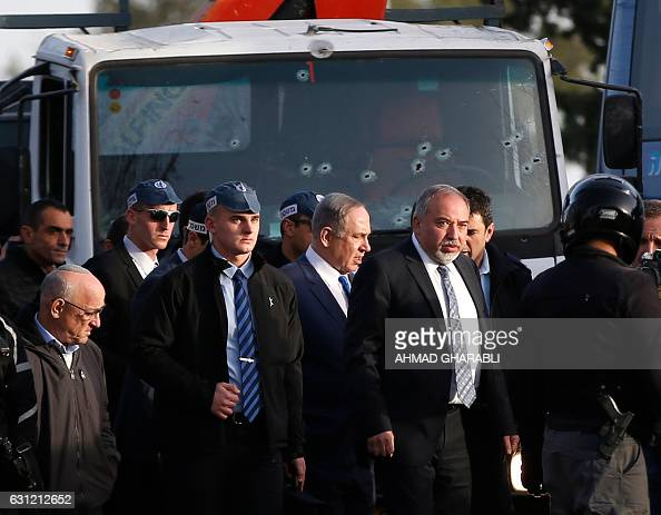 Israeli Defence Minister Avigdor Lieberman and Prime Minister Benjamin Netanyahu visit the site of a vehicleramming attack in Jerusalem on January 8...
