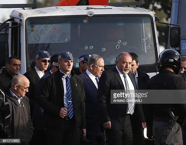 Israeli Defence Minister Avigdor Lieberman and Prime Minister Benjamin Netanyahu visit the site of a vehicleramming attack in Jerusalem on January 8...