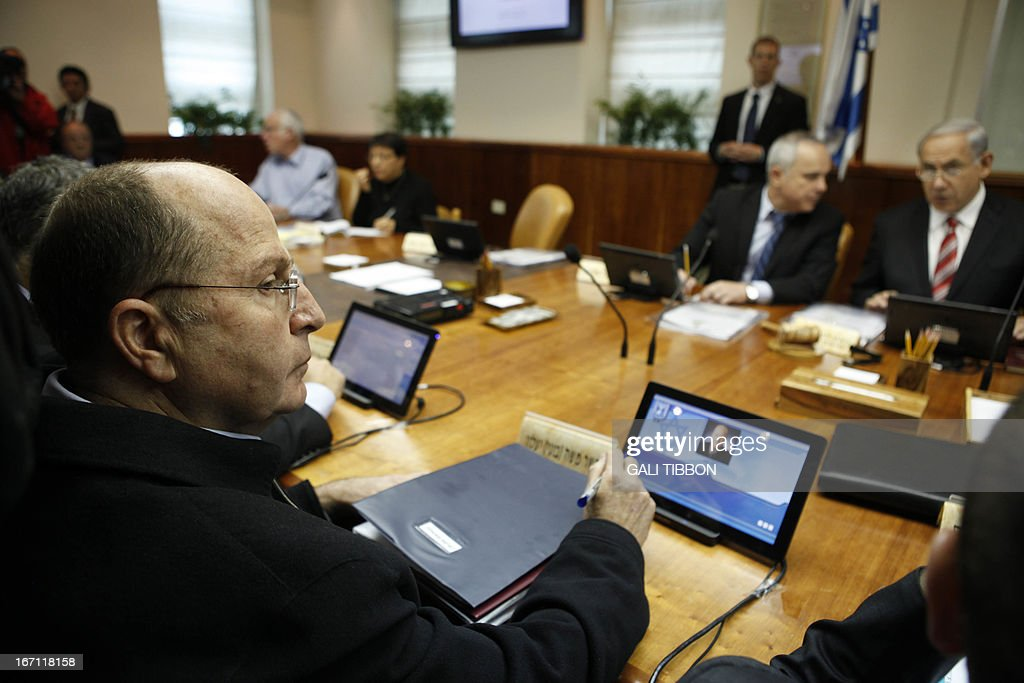 Israeli Defence Minister Moshe Yaalon looks on during the weekly cabinet meeting led by Israel's Prime Minister Benjamin Netanyahu (R) on April 21, 2013 in Jerusalem .