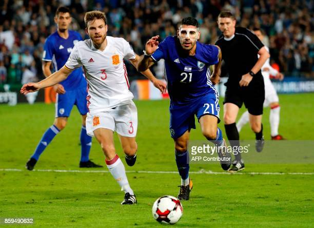 Israeli defender Eytan Tibi vies for the ball with Spain's midfielder Asier Illarramendi during the Russia 2018 FIFA World Cup European Group G...