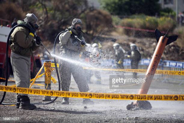 Israeli Defense Forces soldiers from a special unit in the Israeli Home Front Command wearing biohazard suits participate in an army exercise...