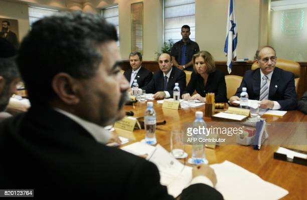 Israeli Defense minister Amir Peretz reviews papers as he attends the weekly cabinet meeting chaired by Israeli Prime Minister Ehud Olmert 25 June...