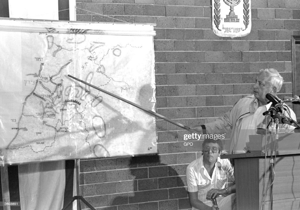 Israeli Defense Minister Ariel Sharon points to a map of Lebanon as he talks to the press about the objectives of the military operation 'Peace For Galilee' June 11, 1982 in the Defense Ministry in Tel Aviv, Israel. Twenty eight survivors of the 1982 Shatilla and Sabra massacre that took place in the Lebanese capital of Beirut presented a crimes against humanity case against Sharon to an investigating judge on June 18, 2001 in Brussels, Belgium. The survivors argued that the Israeli military and Ariel Sharon, who lead the invasion into Lebanon and whose troops surrounded the Palestinian refugee camps as Christian militias killed the people inside, are responsible for the alleged human rights violations that took place there.