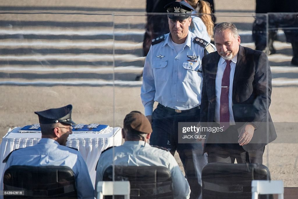 Israeli Defense Minister Avigdor Lieberman (R) attends a graduation ceremony of Israeli air force pilots at the Hatzerim base in the Negev desert, near the southern city of Beer Sheva, on June 30, 2016. / AFP / JACK