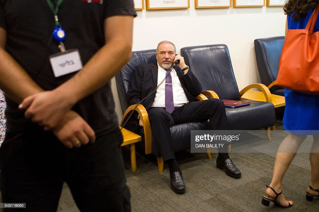 Israeli Defense Minister Avigdor Lieberman speaks on the phone before attending the weekly cabinet meeting at the Israeli Prime Minister's office in Jerusalem on June 26, 2016. / AFP / POOL / Dan Balilty