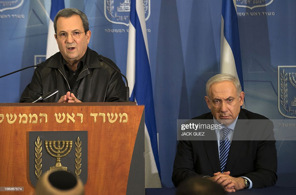 Israeli Defense Minister Ehud Barak (L) and Prime Minister Benjamin Netanyahu (R) address the media at the defense ministry in Tel Aviv on November 14, 2012. Israel sent a 'clear message' to Hamas through the killing of its top military commander and is ready to 'expand' its operation in Gaza if necessary, Israeli Prime Minister Benjamin Netanyahu said .