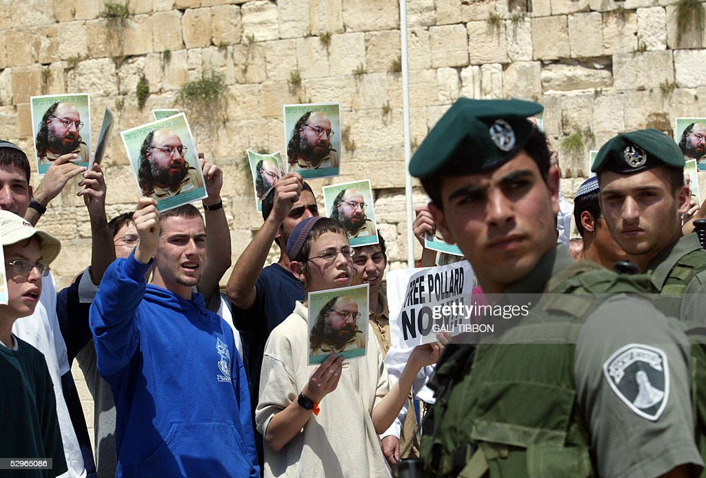 Israeli demonstrators hold up pictures of Jonathan Pollard, a Jewish American who was jailed for life in 1987 on charges of spying on the United States, during the visit of US First Lady Laura Bush at the Western wall the holiest site in Judaism in Jerusalem's old city, 20 May 2005. Pollard, a US Jew sentenced to life in prison for spying for Israel complained bitterly the country was not doing enough to earn his release, after he met the Israeli ambassador to Washington for the first time May 17.