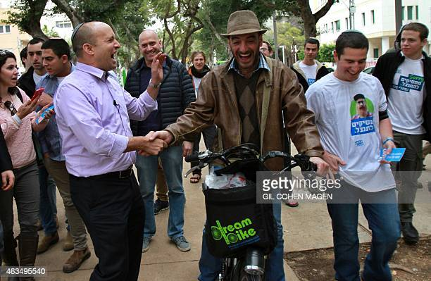 Israeli Economy Minister and head of the farright Jewish Home party Naftali Bennett meets citizens in the streets of the coastal Israeli city of Tel...