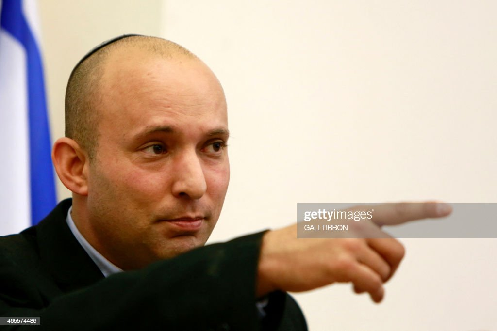 Israeli Economy Minister and head of the far-right Jewish Home party Naftali Bennett speaks during an electoral rally in Jerusalem on March 8, 2015 as part of his campaign ahead of the March 17 general elections. AFP PHOTO/ GALI TIBBON