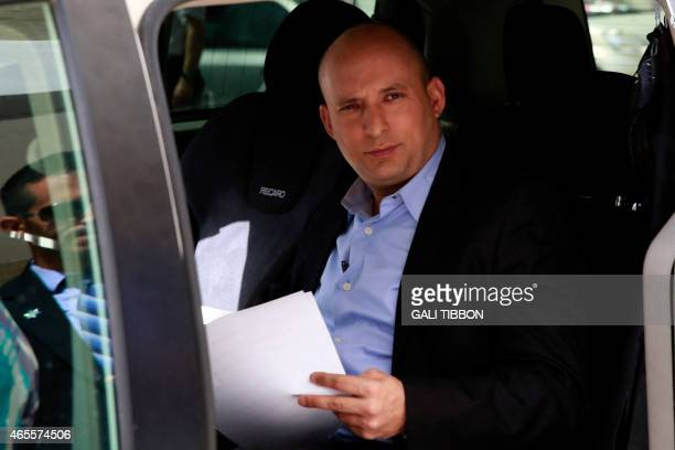 Israeli Economy Minister and head of the farright Jewish Home party Naftali Bennett arrives for an electoral rally in Jerusalem on March 8 2015 as...