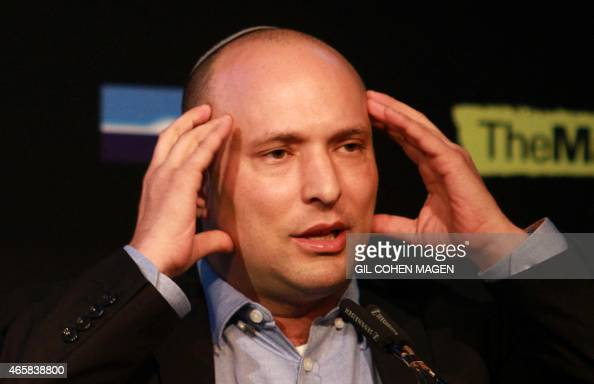 Israeli Economy Minister and head of the farright Jewish Home party Naftali Bennett gives a speech during a debate on economy on March 11 2015 in the...