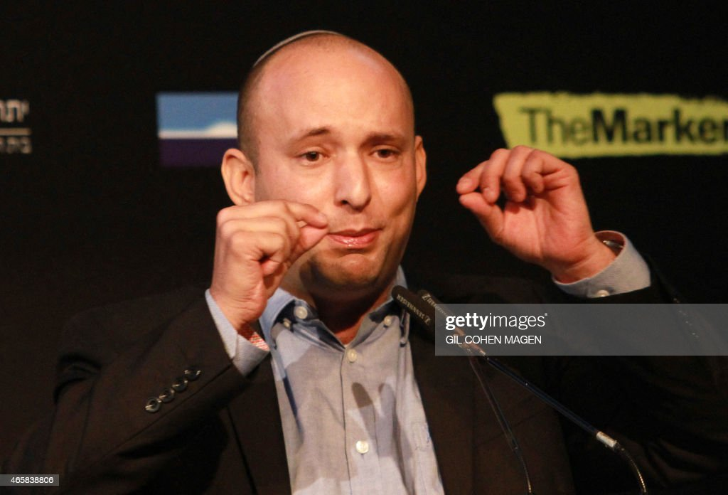 Israeli Economy Minister and head of the far-right Jewish Home party, <a gi-track='captionPersonalityLinkClicked' href=/galleries/search?phrase=Naftali+Bennett&family=editorial&specificpeople=6632880 ng-click='$event.stopPropagation()'>Naftali Bennett</a> gives a speech during a debate on economy on March 11, 2015 in the costal Israeli city of Tel Aviv. Six days before Israel votes in a snap general election, the centre-left Zionist Union opened a lead of several points over the ruling rightwing Likud party, a poll showed. Bennett, 42, is a champion of the settler movement and a key challenger of Netanyahu to head Israel's rightwing.