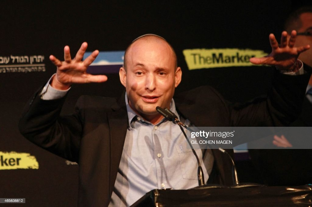 Israeli Economy Minister and head of the far-right Jewish Home party, <a gi-track='captionPersonalityLinkClicked' href=/galleries/search?phrase=Naftali+Bennett&family=editorial&specificpeople=6632880 ng-click='$event.stopPropagation()'>Naftali Bennett</a> gestures as he gives a speech during a debate on economy on March 11, 2015 in the costal Israeli city of Tel Aviv. Six days before Israel votes in a snap general election, the centre-left Zionist Union opened a lead of several points over the ruling rightwing Likud party, a poll showed. Bennett, 42, is a champion of the settler movement and a key challenger of Netanyahu to head Israel's rightwing.