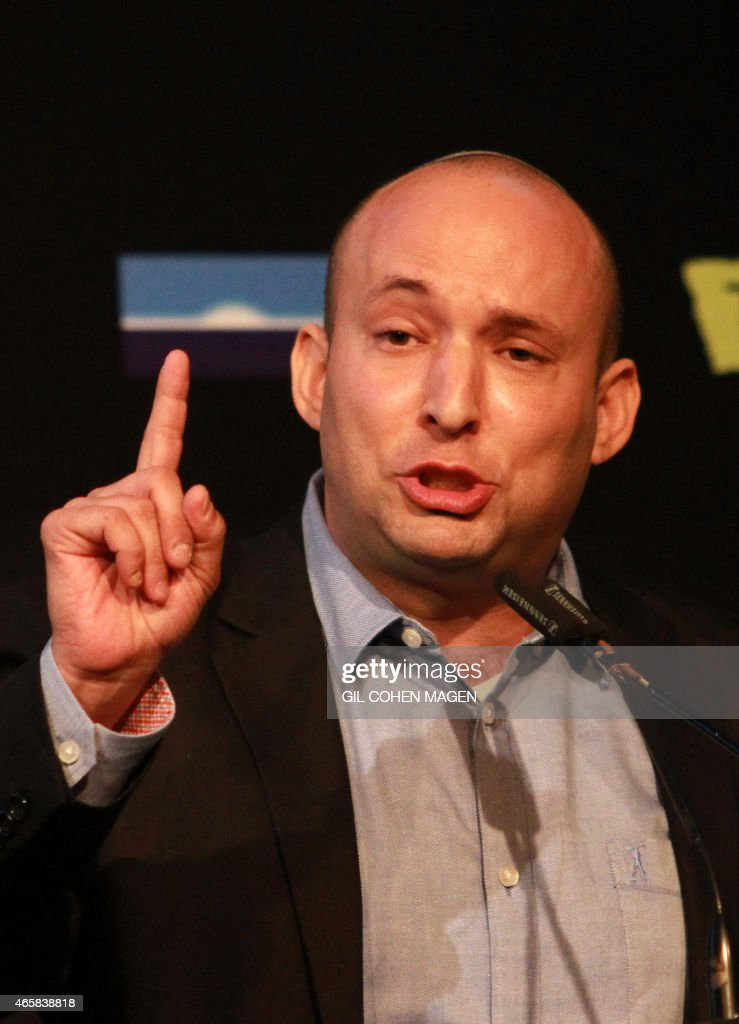Israeli Economy Minister and head of the far-right Jewish Home party, <a gi-track='captionPersonalityLinkClicked' href=/galleries/search?phrase=Naftali+Bennett&family=editorial&specificpeople=6632880 ng-click='$event.stopPropagation()'>Naftali Bennett</a> gestures as he gives a speech during a debate on economy on March 11, 2015 in the costal Israeli city of Tel Aviv. Six days before Israel votes in a snap general election, the centre-left Zionist Union opened a lead of several points over the ruling rightwing Likud party, a poll showed. Bennett, 42, is a champion of the settler movement and a key challenger of Netanyahu to head Israel's rightwing. AFP PHOTO / GIL COHEN-MAGEN