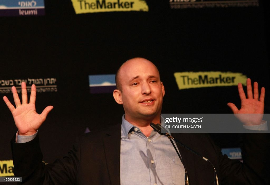 Israeli Economy Minister and head of the far-right Jewish Home party, Naftali Bennett gestures as he gives a speech during a debate on economy on March 11, 2015 in the costal Israeli city of Tel Aviv. Six days before Israel votes in a snap general election, the centre-left Zionist Union opened a lead of several points over the ruling rightwing Likud party, a poll showed. Bennett, 42, is a champion of the settler movement and a key challenger of Netanyahu to head Israel's rightwing. AFP PHOTO / GIL COHEN-MAGEN