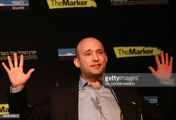 Israeli Economy Minister and head of the farright Jewish Home party Naftali Bennett gestures as he gives a speech during a debate on economy on March...