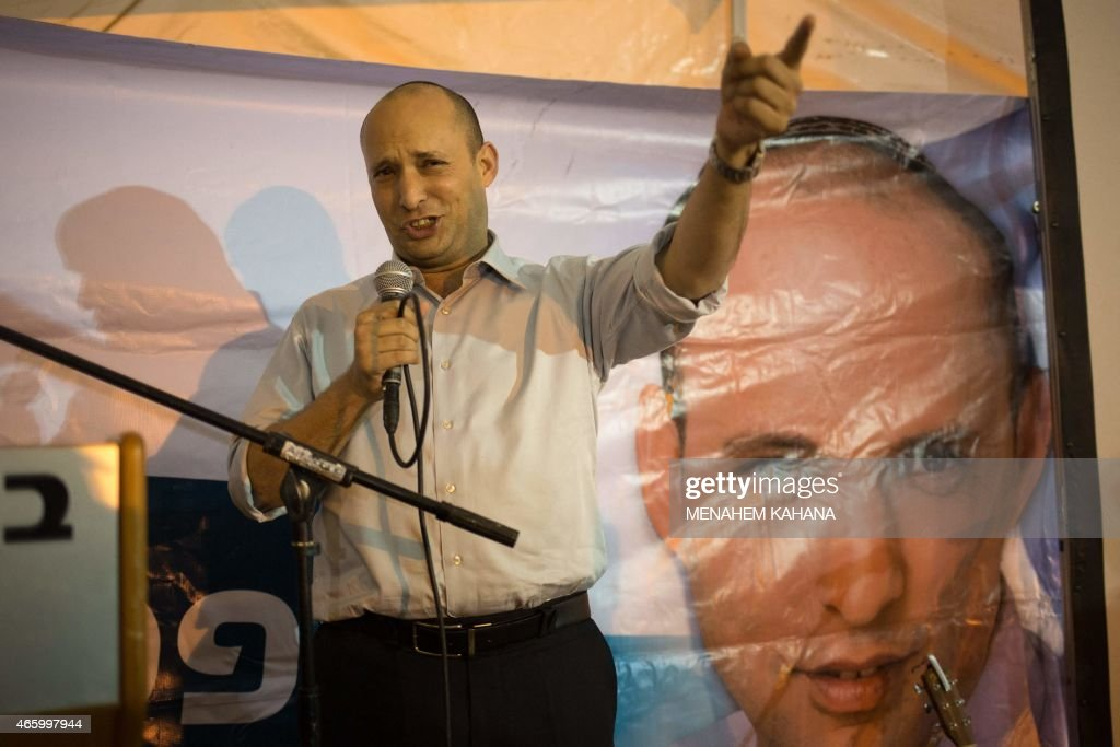 Israeli Economy Minister and head of the right-wing Jewish Home party, Naftali Bennett speaks during an election campaign gathering for the Jewish community in Kibbutz Kfar Etzion in the Gush Etzion settlement block in the West Bank, on March 12, 2015, ahead of a snap general election scheduled March 17. Bennett, 42, is a champion of the settler movement and a key challenger of Netanyahu to head Israel's rightwing.