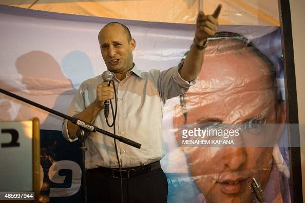 Israeli Economy Minister and head of the rightwing Jewish Home party Naftali Bennett speaks during an election campaign gathering for the Jewish...