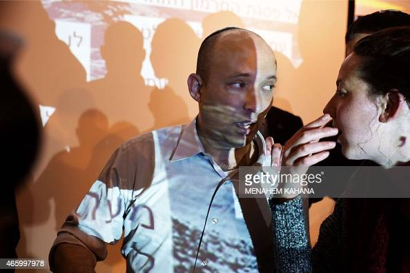 Israeli Economy Minister and head of the rightwing Jewish Home party Naftali Bennett reacts during an election campaign gathering for the Jewish...