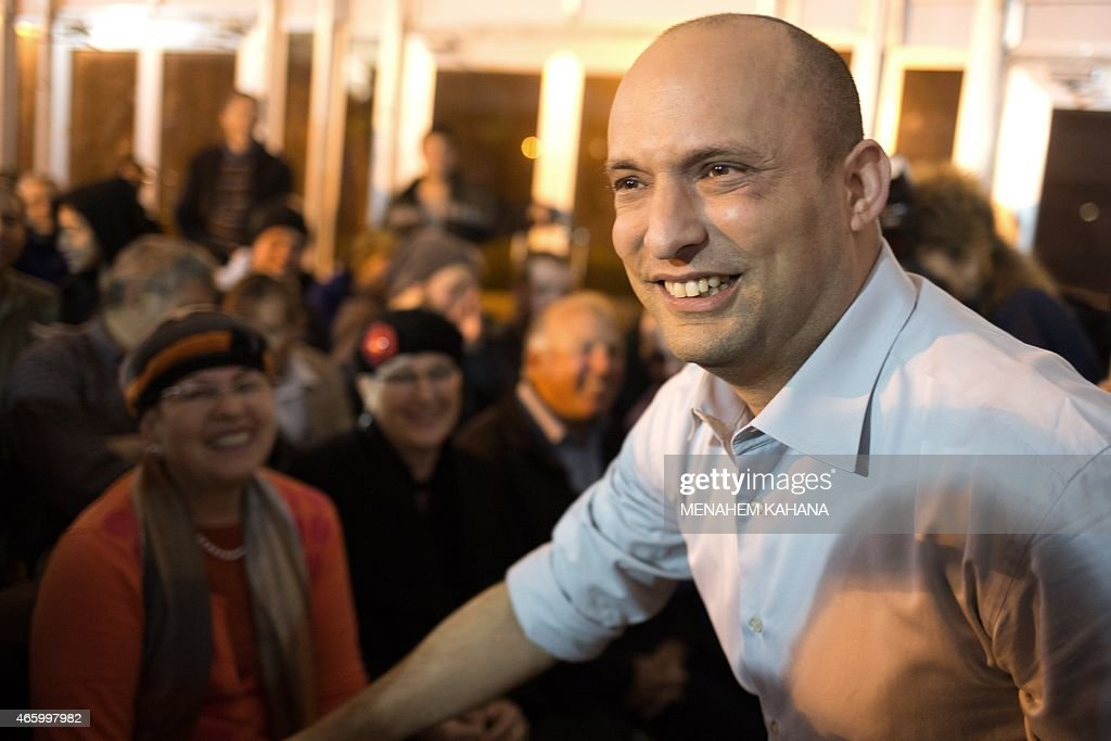Israeli Economy Minister and head of the right-wing Jewish Home party, <a gi-track='captionPersonalityLinkClicked' href=/galleries/search?phrase=Naftali+Bennett&family=editorial&specificpeople=6632880 ng-click='$event.stopPropagation()'>Naftali Bennett</a> reacts during an election campaign gathering for the Jewish community in Kibbutz Kfar Etzion in the Gush Etzion settlement block in the West Bank, on March 12, 2015, ahead of a snap general election scheduled March 17. Bennett, 42, is a champion of the settler movement and a key challenger of Netanyahu to head Israel's rightwing.