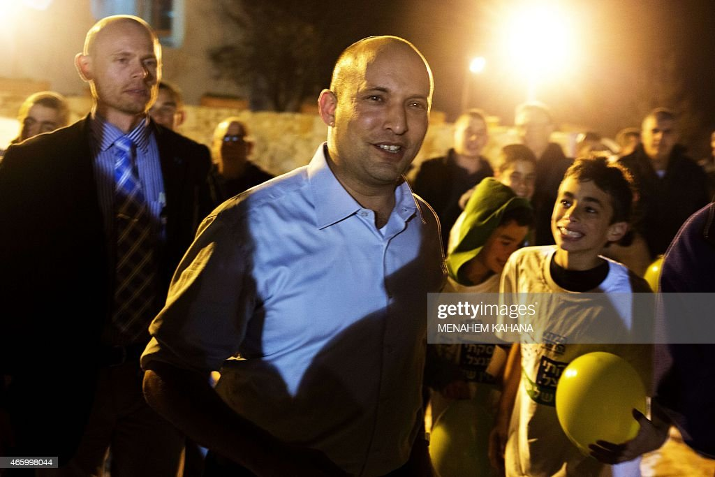 Israeli Economy Minister and head of the right-wing Jewish Home party, Naftali Bennett attends an election campaign gathering for the Jewish community in Kibbutz Kfar Etzion in the Gush Etzion settlement block in the West Bank, on March 12, 2015, ahead of a snap general election scheduled March 17. Bennett, 42, is a champion of the settler movement and a key challenger of Netanyahu to head Israel's rightwing. AFP PHOTO / MENAHEM KAHANA