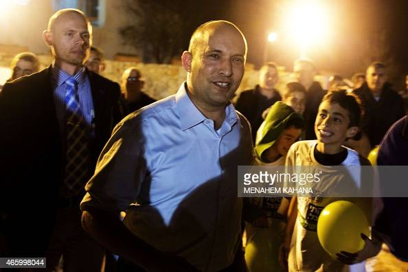 Israeli Economy Minister and head of the rightwing Jewish Home party Naftali Bennett attends an election campaign gathering for the Jewish community...