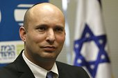 Israeli Economy Minister and head of the ultranationalist party Jewish Home Naftali Bennett speaks during a press conference on December 14 2014 in...