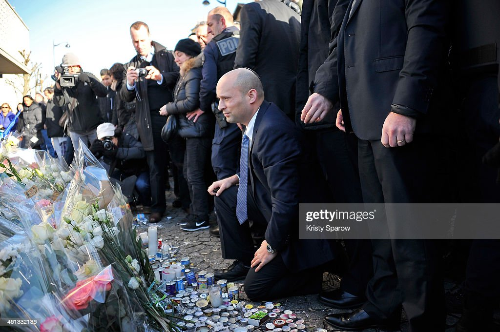 Israeli Economy Minister, <a gi-track='captionPersonalityLinkClicked' href=/galleries/search?phrase=Naftali+Bennett&family=editorial&specificpeople=6632880 ng-click='$event.stopPropagation()'>Naftali Bennett</a> pays his respects at the Hyper Cacher prior to a mass unity rally to be held in Paris following the recent terrorist attacks on January 11, 2015 in Paris, France. An estimated one million people are expected to converge in central Paris for the Unity March joining in solidarity with the 17 victims of this week's terrorist attacks in the country. French President Francois Hollande will lead the march and will be joined by world leaders in a sign of unity. The terrorist atrocities started on Wednesday with the attack on the French satirical magazine Charlie Hebdo, killing 12, and ended on Friday with sieges at a printing company in Dammartin en Goele and a Kosher supermarket in Paris with four hostages and three suspects being killed. A fourth suspect, Hayat Boumeddiene, 26, escaped and is wanted in connection with the murder of a policewoman.Ê