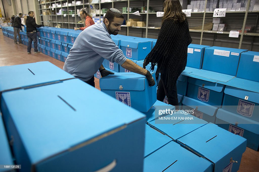 Israeli electoral workers arrange ballot boxes at the headquarters of the Israeli Elections Committee, near the central Israeli town of Shoham, on January 8, 2013. Israelis will vote in general elections on January 22.