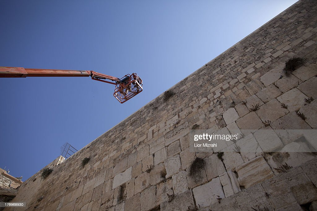 Israeli engineers on a crane check the stability of the structure of the Western Wall stones, Judaism's holiest site, on August 20, 2013 in Jerusalem Old City ,Israel. The operation is carried out twice each year before the Passover festival and at the Jewish New Year which begins in two weeks.