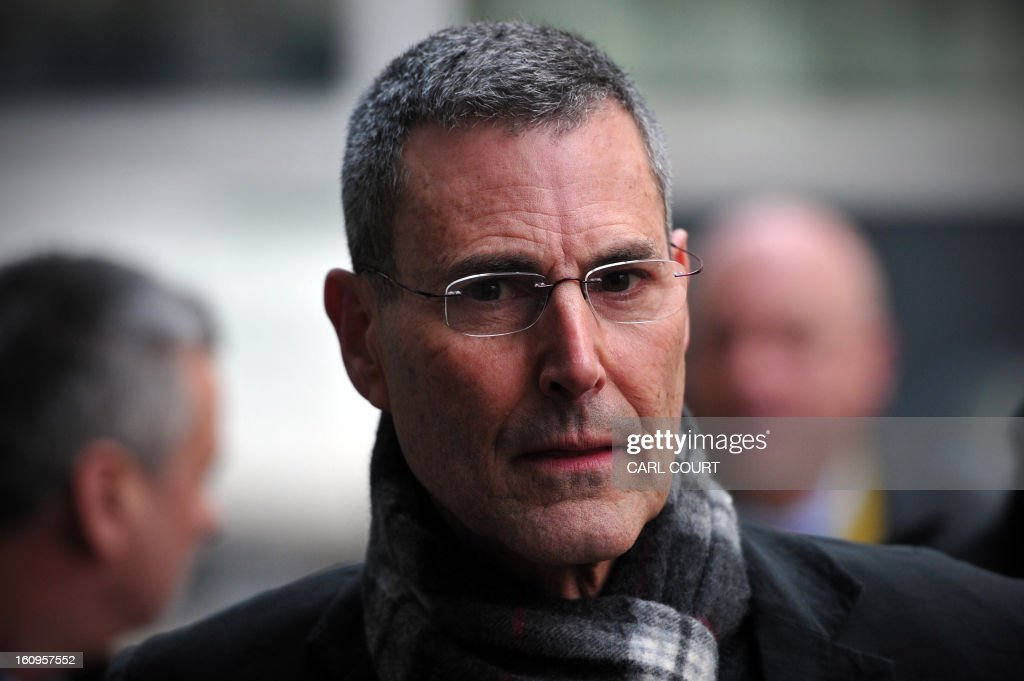 Israeli entertainer Uri Geller arrives to attend a hearing in civil cases taken against Rupert Murdoch's News Group Newspapers over phone hacking at the High Court in central London on February 8, 2013. Geller, was one of 17 people who settled their claims at London's High Court on February 8 brought against Rupert Murdoch's News Group Newspapers, publishers of the now-defunct News of the World tabloid newspaper, over phone hacking. Revelations that the News of the World had hacked celebrities led Murdoch to shut down the tabloid in July 2011.