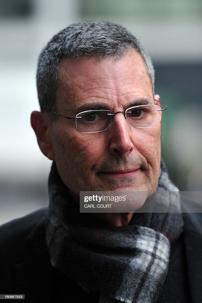 Israeli entertainer Uri Geller arrives to attend a hearing in civil cases taken against Rupert Murdoch's News Group Newspapers over phone hacking at the High Court in central London on February 8, 2013. Geller, was one of 17 people who settled their claims at London's High Court on February 8 brought against Rupert Murdoch's News Group Newspapers, publishers of the now-defunct News of the World tabloid newspaper, over phone hacking. Revelations that the News of the World had hacked celebrities led Murdoch to shut down the tabloid in July 2011. AFP PHOTO / CARL COURT