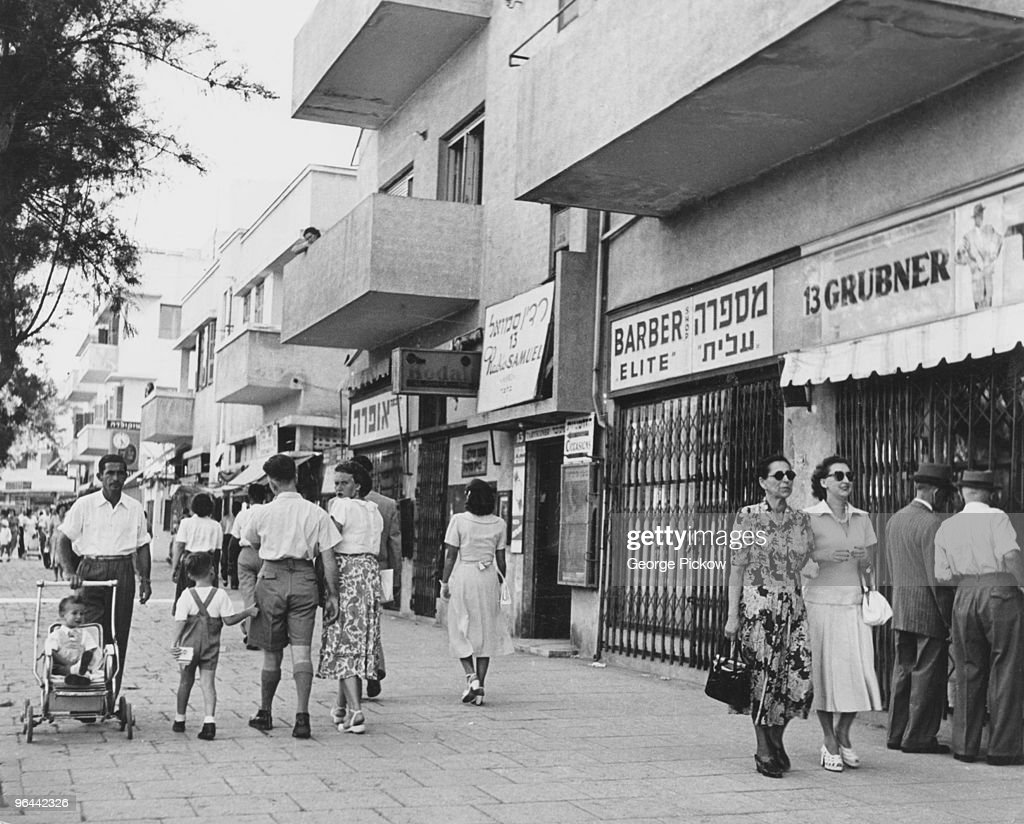 Israeli families out on Sabbath day walks Tel Aviv Israel circa 1955