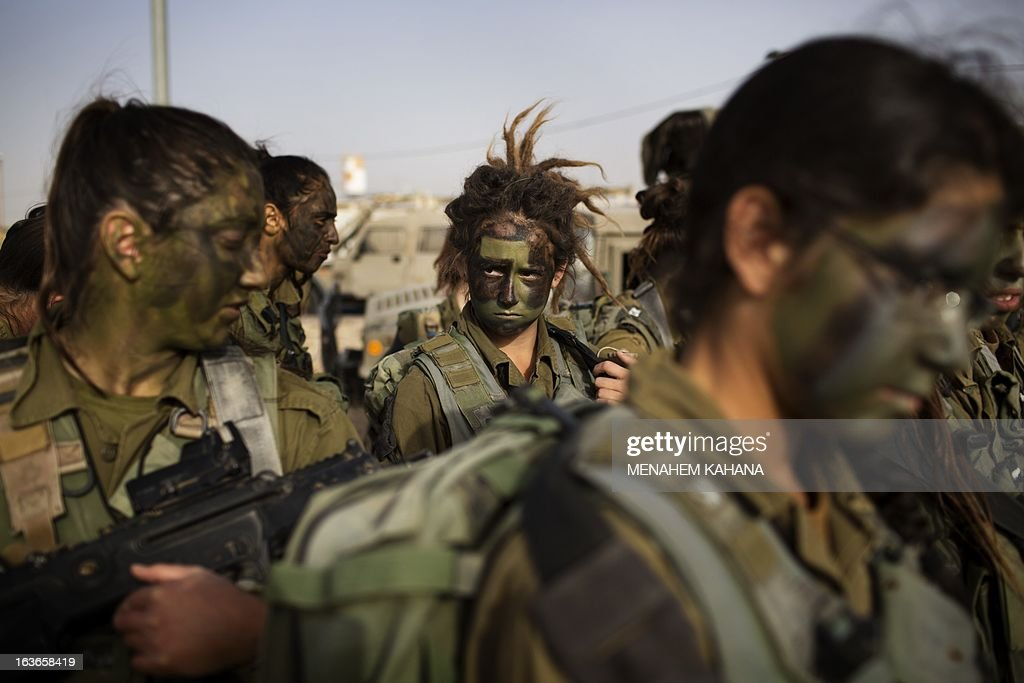 Israeli female soldiers of the 33rd Caracal Battalion take part in a graduation march in the northern part of the southern Israeli Negev desert, on March 13 2013. The Caracal unit is an infantry combat battalion of the army, composed of both male and female soldiers mostly serving along the Israeli southern desert borders.