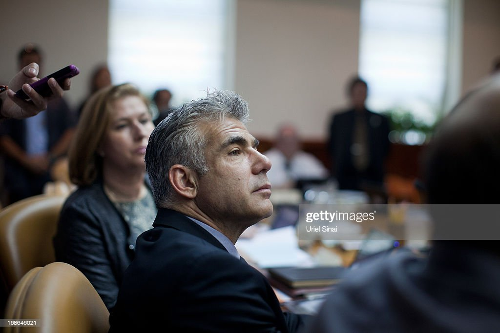 Israeli Finance Minister and leader of the Yesh Atid party Yair Lapid at the Israeli weekly cabinet meeting at the Prime Minister's office on May 13, 2013 in Jerusalem, Israel.