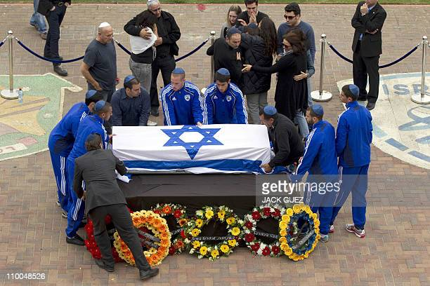 Israeli football players place the coffin of football icon and former Liverpool player Avi Cohen as hundreds of fans gather at Tel Aviv's Ramat Gan...