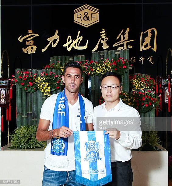 Israeli footballer Eran Zahavi poses for photo shoots after moving to Guangzhou RF FC on June 29 2016 in Guangzhou China Eran Zahavi signed a 25year...
