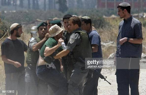 Israeli forces clash with Israeli settlers who were trying to prevent Palestinian motorists from driving and throwing stones at them near the Hawara...