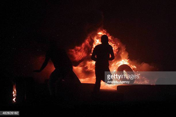 Israeli forces clashes with the Palestinian demonstrators at the Qalandia checkpoint during the rally in Ramallah West Bank on July 24 2014 Thousands...