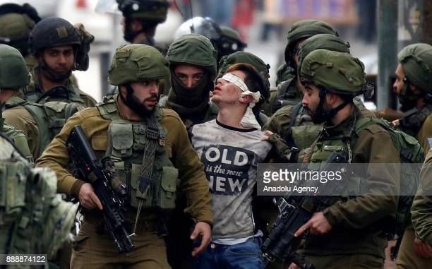 Israeli forces detain Palestinian Fevzi ElJunidi 14yearold following clashes after protests against a decision by US President Donald Trump to...