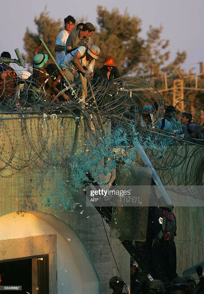 Israeli forces storm the roof of a synagogue in the southern Gaza Strip settlement of Kfar Darom 18 August 2005Israeli forces raided synagogues in...