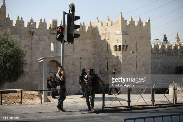 Israeli forces take security measures at the scene after Israeli soldiers shot 3 Palestinians who allegedly carried a gun and opened fire before...