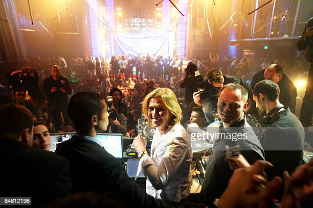 Israeli Foreign Minister and Kadima party candidate Tzipi Livni dances in the DJ booth during an election campaign party at the Ha'oman 17 dance club...