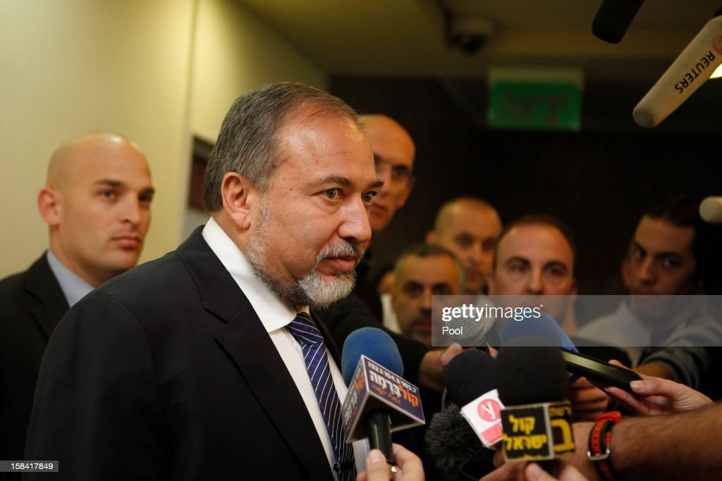 Israeli Foreign Minister Avigdor Lieberman speaks to the press after handing his resignation before arriving for the weekly cabinet meeting at his office on December 16, 2012 in Jerusalem, Israel. Israeli Prime Minister Benjamin Netanyahu spoke at the cabinet meeting following Lieberman's announced resignation.